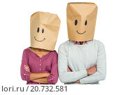 Купить «Couple covering their faces with paper bag with arms crossed», фото № 20732581, снято 28 мая 2015 г. (c) Wavebreak Media / Фотобанк Лори