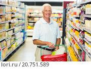 Купить «Senior man buying food», фото № 20751589, снято 15 апреля 2015 г. (c) Wavebreak Media / Фотобанк Лори