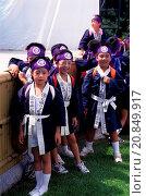 Купить «Local teenagers in traditional costume during a farmers festival in the Korakuen Garden, a Japanese garden located in Okayama in Japan.», фото № 20849917, снято 3 ноября 2014 г. (c) age Fotostock / Фотобанк Лори