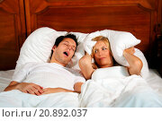 Купить «snoring man and his enervated woman, covering her ears with a pillow», фото № 20892037, снято 25 ноября 2018 г. (c) age Fotostock / Фотобанк Лори
