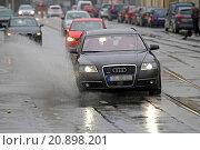Купить «car splashing through a puddle, Germany», фото № 20898201, снято 21 февраля 2015 г. (c) age Fotostock / Фотобанк Лори