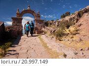 Купить «Tourists walking up the stairs to reach the town center passing through a gate, Taquile Island, Titicaca Lake, Puno Region, Peru, South America.», фото № 20997149, снято 18 июня 2015 г. (c) age Fotostock / Фотобанк Лори