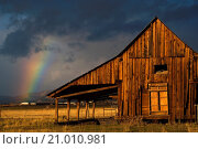 Купить «Rainbow and storm clouds at sunrise over old wooden barn, near Susanville, Lassen County, California.», фото № 21010981, снято 6 ноября 2009 г. (c) age Fotostock / Фотобанк Лори