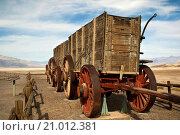 Купить «Twenty Mule Team wagons, Harmony Borax Works, Death Valley National Park, California.», фото № 21012381, снято 18 октября 2009 г. (c) age Fotostock / Фотобанк Лори