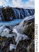 Купить «Ice has been left behind after the Bruarfoss waterfall has melted; Iceland», фото № 21069021, снято 16 июля 2019 г. (c) age Fotostock / Фотобанк Лори