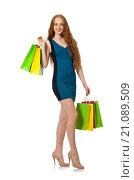 Купить «Woman with shopping bags isolated on white», фото № 21089509, снято 28 октября 2015 г. (c) Elnur / Фотобанк Лори