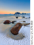 Купить «Dawn illuminates the rocks shaped by wind surrounded by fresh snow. Uttakleiv Lofoten Islands Norway Europe.», фото № 21379969, снято 4 февраля 2015 г. (c) age Fotostock / Фотобанк Лори