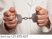 Купить «Doctor in handcuffs.», фото № 21475437, снято 2 марта 2015 г. (c) easy Fotostock / Фотобанк Лори