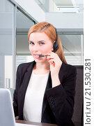 Купить «Businesswoman sit at desk and talking on headset», фото № 21530281, снято 15 октября 2013 г. (c) easy Fotostock / Фотобанк Лори