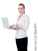 Купить «Smiling corporate woman using labtop», фото № 21554477, снято 28 мая 2013 г. (c) easy Fotostock / Фотобанк Лори