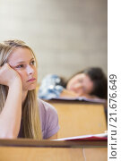 Купить «Bored student listening while classmate sleeping», фото № 21676649, снято 8 июля 2015 г. (c) Wavebreak Media / Фотобанк Лори