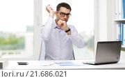 Купить «busy businessman with laptop and papers in office», видеоролик № 21686021, снято 9 июля 2015 г. (c) Syda Productions / Фотобанк Лори