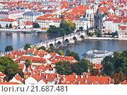 Купить «Top view of Prague, red roofs, Charles bridge and the Vltava river, Czech Republic», фото № 21687481, снято 7 сентября 2014 г. (c) Наталья Волкова / Фотобанк Лори