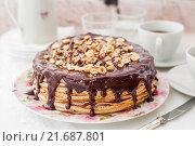 Купить «Торт из блинов с орехами и шоколадной глазурью», фото № 21687801, снято 4 января 2016 г. (c) Татьяна Ворона / Фотобанк Лори