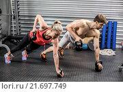 Купить «Couple doing push up with dumbbells», фото № 21697749, снято 18 сентября 2015 г. (c) Wavebreak Media / Фотобанк Лори
