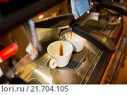 Купить «close up of espresso machine making coffee», фото № 21704105, снято 1 декабря 2015 г. (c) Syda Productions / Фотобанк Лори