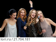 Купить «happy young women with microphone singing karaoke», фото № 21704181, снято 21 ноября 2015 г. (c) Syda Productions / Фотобанк Лори