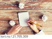 Купить «close up of hands with notebook and pencil», фото № 21705309, снято 10 октября 2014 г. (c) Syda Productions / Фотобанк Лори