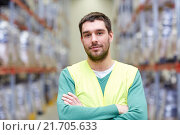 Купить «happy man in reflective safety vest at warehouse», фото № 21705633, снято 9 декабря 2015 г. (c) Syda Productions / Фотобанк Лори