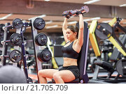 Купить «young woman flexing muscles with dumbbell in gym», фото № 21705709, снято 12 декабря 2015 г. (c) Syda Productions / Фотобанк Лори