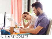 Купить «creative team with reading paper in office», фото № 21706849, снято 29 марта 2015 г. (c) Syda Productions / Фотобанк Лори