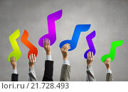 Купить «Music notes in hands», фото № 21728493, снято 22 мая 2019 г. (c) Sergey Nivens / Фотобанк Лори