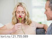 Купить «Pretty woman smelling a rose offered by husband», фото № 21755089, снято 9 сентября 2015 г. (c) Wavebreak Media / Фотобанк Лори