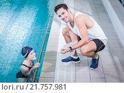 Купить «Fit trainer talking to swimmer», фото № 21757981, снято 11 октября 2015 г. (c) Wavebreak Media / Фотобанк Лори