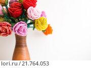 Купить «Цветы из бус в вазе на белом фоне», фото № 21764053, снято 7 февраля 2016 г. (c) Инга Макеева / Фотобанк Лори
