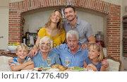 Купить «Portrait of multi generation family at lunch», видеоролик № 21776409, снято 27 июня 2019 г. (c) Wavebreak Media / Фотобанк Лори