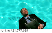 Купить «Businessman floating in the pool», видеоролик № 21777689, снято 23 ноября 2019 г. (c) Wavebreak Media / Фотобанк Лори