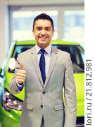 Купить «man showing thumbs up at auto show or car salon», фото № 21812981, снято 22 января 2015 г. (c) Syda Productions / Фотобанк Лори