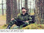 Купить «soldier or hunter with gun sleeping in forest», фото № 21813121, снято 14 августа 2014 г. (c) Syda Productions / Фотобанк Лори
