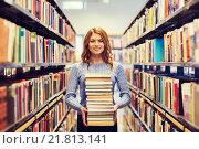 Купить «happy student girl or woman with books in library», фото № 21813141, снято 6 марта 2015 г. (c) Syda Productions / Фотобанк Лори