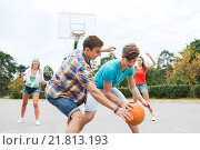 Купить «group of happy teenagers playing basketball», фото № 21813193, снято 10 августа 2014 г. (c) Syda Productions / Фотобанк Лори