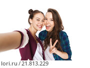 Купить «happy friends taking selfie and showing peace», фото № 21813229, снято 19 декабря 2015 г. (c) Syda Productions / Фотобанк Лори