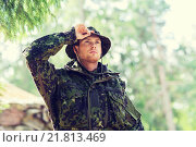 Купить «young soldier or ranger in forest», фото № 21813469, снято 14 августа 2014 г. (c) Syda Productions / Фотобанк Лори