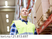 Купить «man in reflective safety vest at warehouse», фото № 21813697, снято 9 декабря 2015 г. (c) Syda Productions / Фотобанк Лори