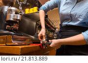 Купить «close up of woman making coffee by machine at cafe», фото № 21813889, снято 1 декабря 2015 г. (c) Syda Productions / Фотобанк Лори