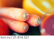 Купить «close up of carrot with fruits and vegetables», фото № 21814321, снято 17 марта 2015 г. (c) Syda Productions / Фотобанк Лори
