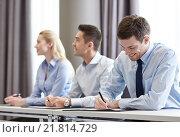 Купить «group of smiling businesspeople meeting in office», фото № 21814729, снято 25 октября 2014 г. (c) Syda Productions / Фотобанк Лори