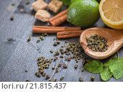 Купить «Корица, лимон, травы и сахар на деревянном столе», фото № 21815437, снято 14 июня 2015 г. (c) Jan Jack Russo Media / Фотобанк Лори