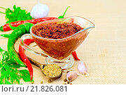 Купить «Adjika in glass gravy boat with garlic on sacking», фото № 21826081, снято 20 марта 2019 г. (c) easy Fotostock / Фотобанк Лори
