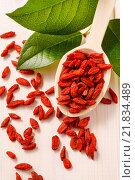 Купить «Spoon of dried goji berries, wooden background. Healthy food», фото № 21834489, снято 19 июня 2019 г. (c) BE&W Photo / Фотобанк Лори