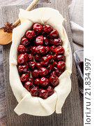 Купить «French puff pastry with cherries before baking. Party dessert», фото № 21834997, снято 22 октября 2018 г. (c) BE&W Photo / Фотобанк Лори