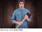 Купить «Composite image of serious hipster wearing knitted hat holding axe», фото № 21838589, снято 21 августа 2018 г. (c) Wavebreak Media / Фотобанк Лори