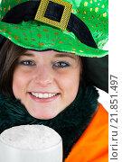 Купить «Pretty brunette celebrating Saint Patricks day», фото № 21851497, снято 20 февраля 2015 г. (c) Wavebreak Media / Фотобанк Лори