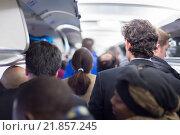 Купить «Пассажиры в салоне самолета», фото № 21857245, снято 21 ноября 2018 г. (c) Matej Kastelic / Фотобанк Лори