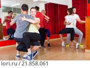 Купить «Group of people dancing salsa in studio», фото № 21858061, снято 10 апреля 2020 г. (c) Яков Филимонов / Фотобанк Лори