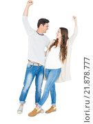 Купить «Triumphant couple raising fist», фото № 21878777, снято 7 октября 2015 г. (c) Wavebreak Media / Фотобанк Лори